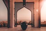 Sun sets on patio overlooking the ocean - 183522744