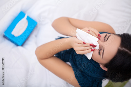 Flu. Woman Suffering From Cold Lying In Bed With Tissue