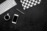 Concept of the strict office desk in monochrome. Keyboard, notebook, cell phone,  coffee on black background top view copyspace - 183527343