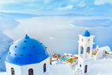 Greece, Santorini island in Aegean sea. Breathtaking scenery with blue domed church on foreground and epic island panorama in background.