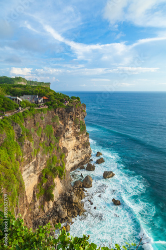 Staande foto Bali View of Uluwatu cliff with tourists, pavilion and blue sea in Bali, Indonesia