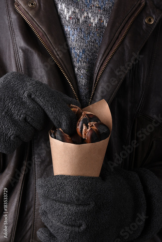 Closeup Man with Bag of Roasted Chestnuts