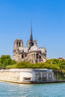 Notre Dame de Paris Catholic Christian Cathedral with the Seine river on a sunny spring day. Paris