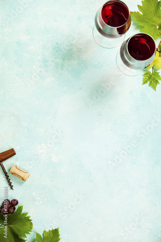 Wine and grapes over blue vintage background