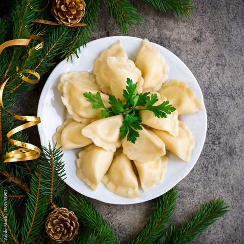 Christmas dumplings with decoration on a grey board. Top view. - 183543902