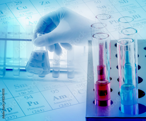 laboratory glassware with chemicals on hand hold chemicals glass