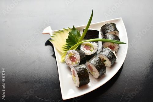 Plexiglas Sushi bar Sushi maki tuna, salmon, white plate, dark background