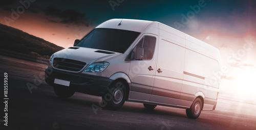 Fototapeta White van for freight haulage on a freeway