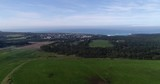 Cultivated agriculture fields on farms surrounding Port Campbell town on Great Ocean road and national park.  - 183563977