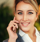technology, communication and people concept - happy woman calli - 183566368
