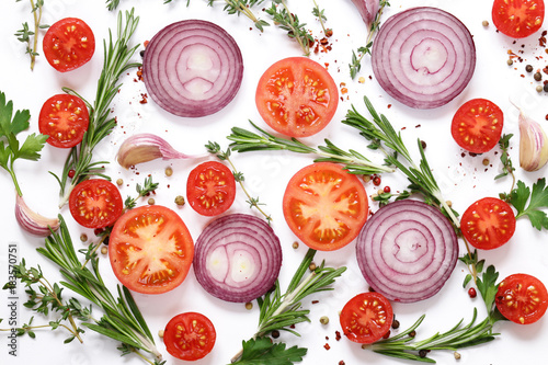 fresh vegetables and herbs on a white background - food background