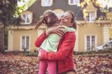 Little girl hugging her Mother, share love. - 183575719