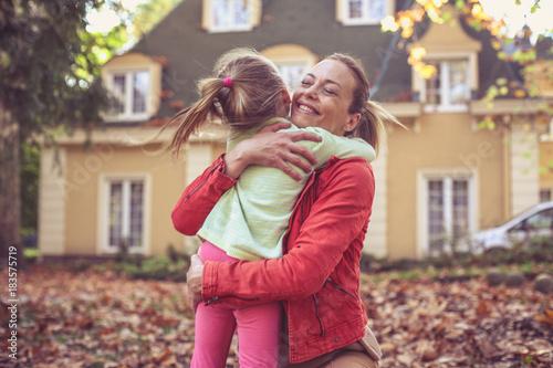 Little girl hugging her Mother, share love.