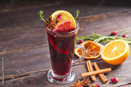 mulled wine on the wooden background