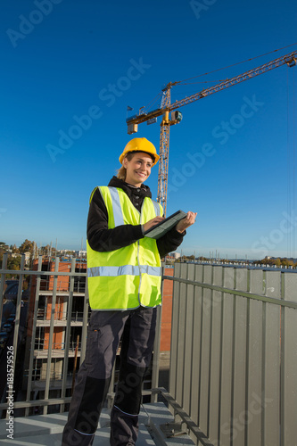 female construction worker at rooftop