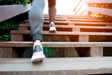 A man step up to success, sport man is climbing on wooden step - 183584995