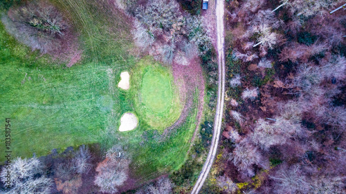 Plexiglas Olijf Drone view of a golf course with beautiful nature and a footpath