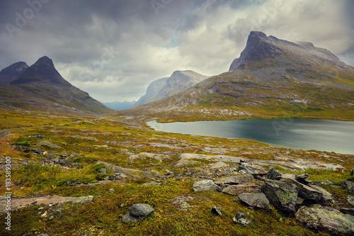 Plexiglas Bergrivier Mountain landscape. Rocky shore of mountain lake in rainy autumn morning. Beautiful nature Norway.