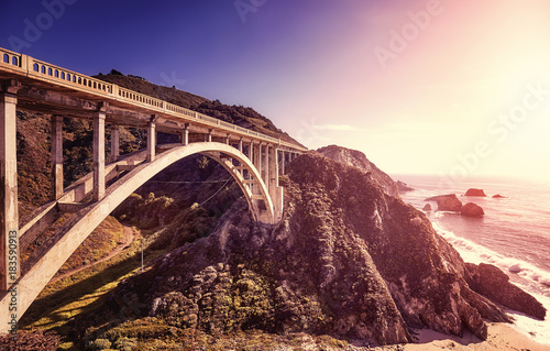 Sticker Vintage toned picture of the Bixby Creek Bridge at sunset, Pacific Coast Highway, California, USA.