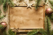 Blank paper sheet in picture frame and spruce tree