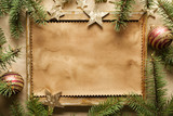 Blank paper sheet in picture frame and spruce tree - 183593914