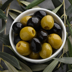Olives with olive branch and olive oil, view from above