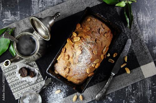 кекс с арахисом с форме для запекания с  горячим чаем Poster