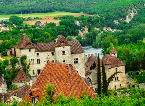 Fotobehang Groene Saint Cirq Lapopie, medieval town in the south fo France, on a cloudy day.