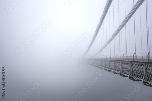 Wall mural Clifton Suspension Bridge in the fog from the side