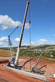 Cranes lifting concrete bridge beams - 183626394