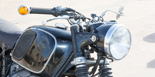 Aluminium Fiets frontlight and the handlebar and the tank of a vintage motorcycle collection