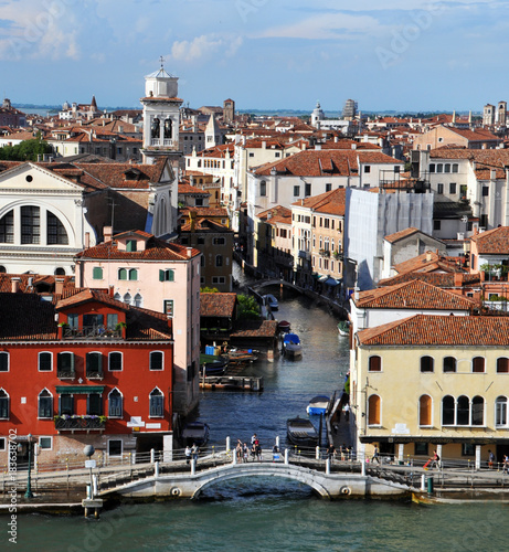 Wall mural panoramic view of Venice from the height of the cruise ship to Piazza San Marco and the Ducale, or Doge's Palace. on the Grand canal many boats, river transport, in the background of ancient architect