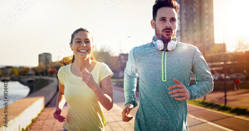 Fotobehang Hardlopen Friends fitness training together outdoors living active healthy