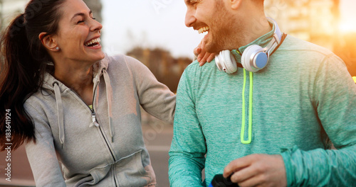 Plexiglas Fitness Happy young sporty couple sharing romantic moments