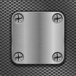 Square metal plate on perforated background