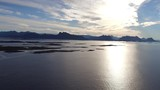 Aerial Drone beautiful waterscape ocean with sunlight in Norway Mountain silhouette 4k - 183653791
