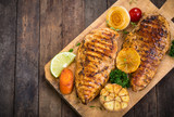 Grilled chicken breast on the cutting board  - 183654558