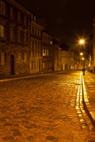 Mostowa street in Warsaw in the evening with lanterns in orange colors - 183656355