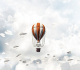 Flying hot air balloon in the air. - 183665142
