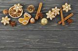 Christmas composition. Cinnamon sticks, anise, gingerbread, hazelnuts and oranges on old wooden table. Top view. - 183671192