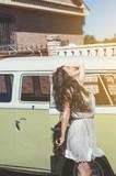 Teenage woman celebrates happy next to a van - 183675505