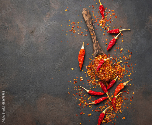 Tuinposter Hot chili peppers Red hot chili peppers on rusty background