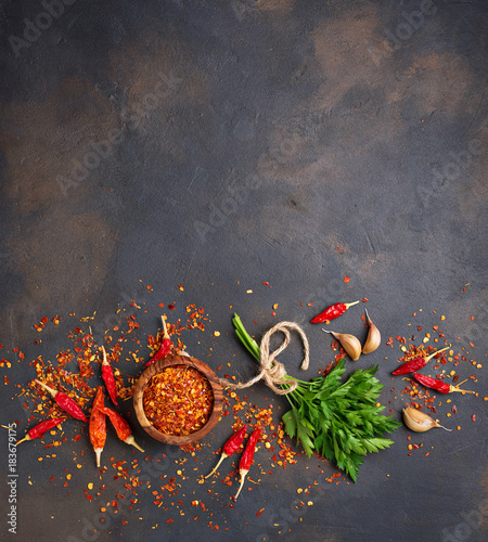 Red chili peppers, garlic and parsley  - 183679175