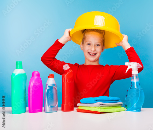 a little girl with cleaning products
