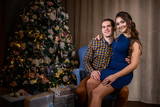 Beautiful young couple in the New Year's atmosphere, photo session in the studio - 183689537
