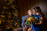 Beautiful young couple in the New Year's atmosphere, photo session in the studio - 183690328