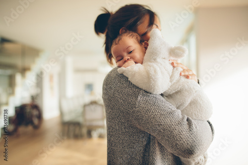 Newborn boy in his mother's arms