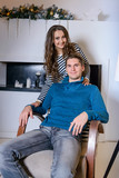 Beautiful young couple in the New Year's atmosphere, photo session in the studio - 183691383