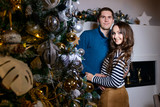 Beautiful young couple in the New Year's atmosphere, photo session in the studio - 183691510