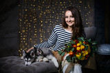 Beautiful girl in a Christmas atmosphere with puppies Husky - 183691732